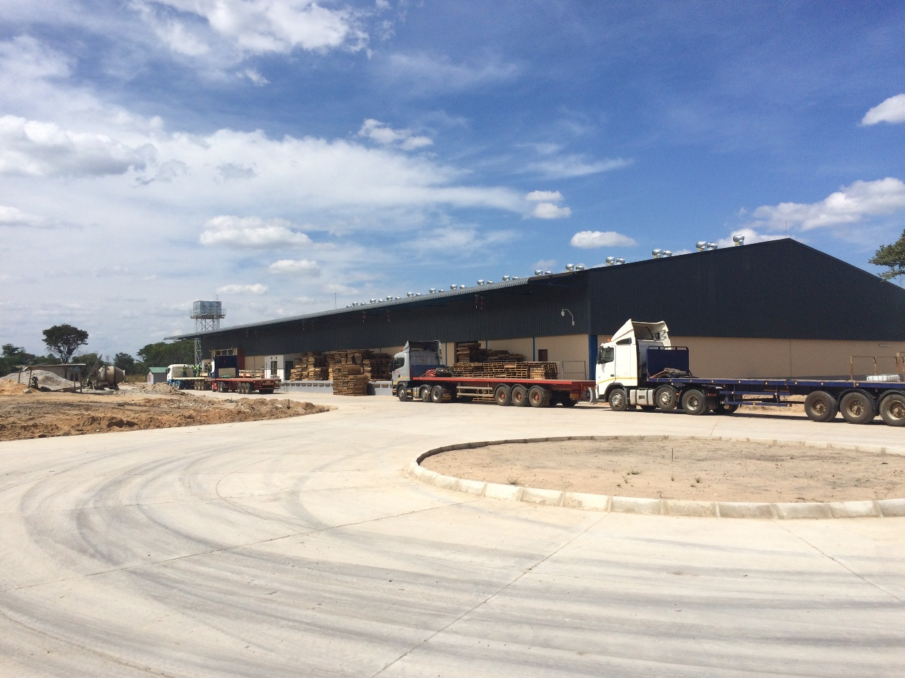 Concrete roundabout and warehouse